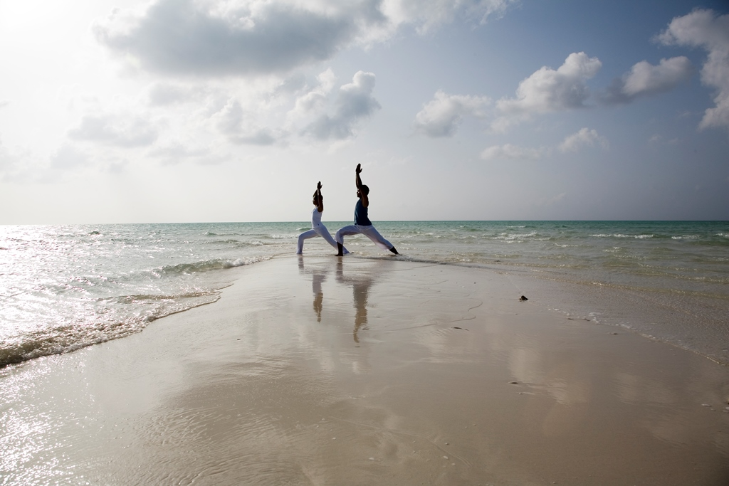 055026_44119140_Yoga_by_the_beach-1